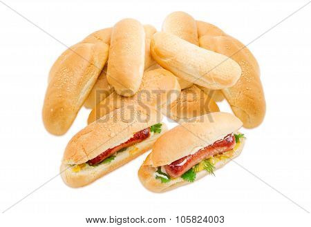 Two Hot Dog And Pile Of A Buns With Sesame