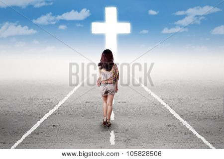 Girl Doing A Holy Trip To The Cross
