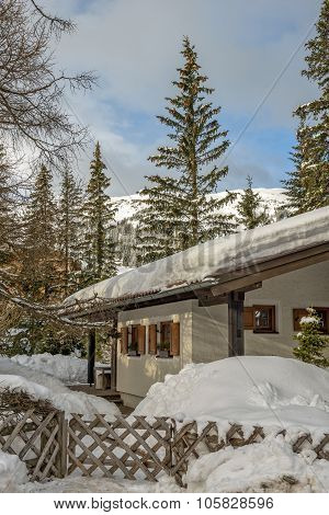 Mountain Chalet In Winter Alps