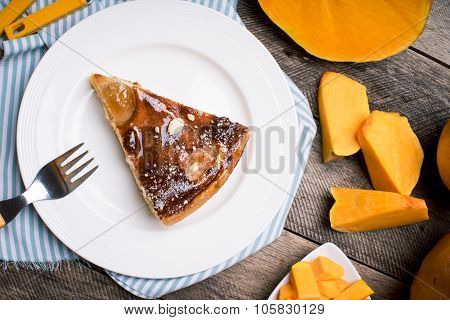 Breakfast Piece Of Pie And Pumpkin Slices In Rustic Style