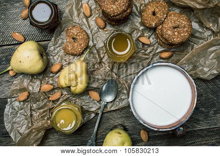 Cookies Pears Honey And Yoghurt On Wooden Table
