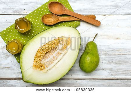Healthy Melon Green Pear And Honey On Rustic Wood
