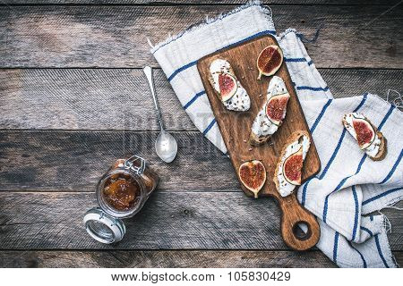 Healthy Snacks With Cheese And Figs On Wood Board