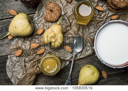 Pastry Pears Honey And Yoghurt On Wooden Table