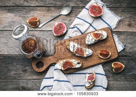 Rustic Style Food Snaks With Jam And Figs On Napkin
