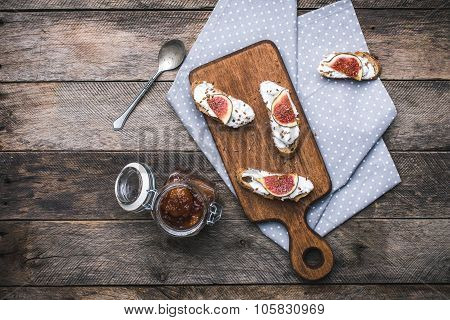 Rustic Style Tasty Bruschetta Snacks With Jam And Figs