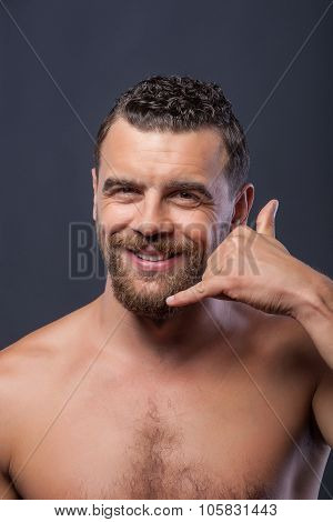 Attractive bearded guy is gesturing with positive emotions