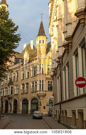 RIGA, LATVIA - CIRCA SEN, 2015: One of the streets in medieval town of old Riga. Riga has long been a Hanseatic city, there are buildings of different styles from medieval to modern architecture.