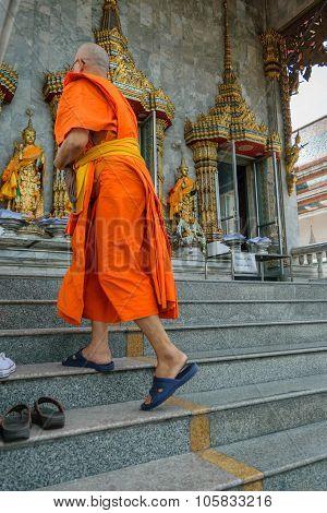 Thai Monk Walking In Temple To Worship
