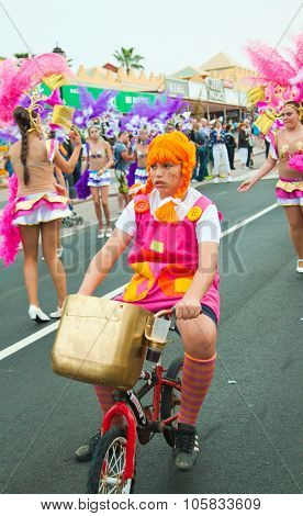 Corralejo - March 17: Dressed-up Child On A Bike Goes Along With Grand Carnival Parade, March 17, 20