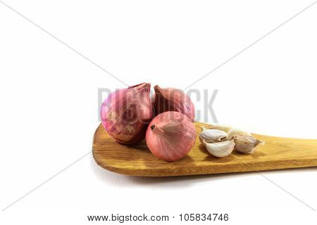 Shallot Or Onions And Garlic On Wooden Spoon