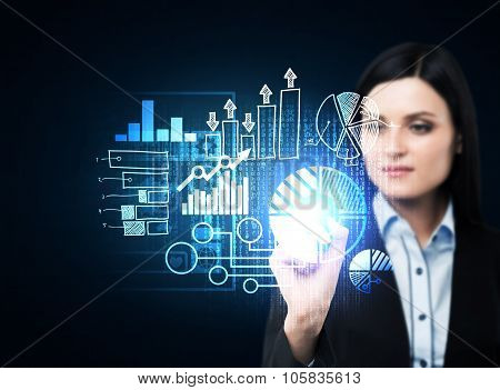 A Business Woman In Formal Suit Is Pushing Out The Element On The Hologram With Business Icons. Dark