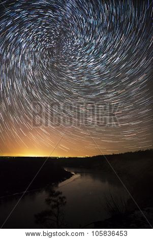 beautiful night sky spiral star trails and the forest