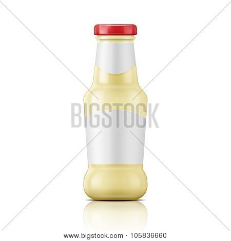 White sauce in glass bottle.