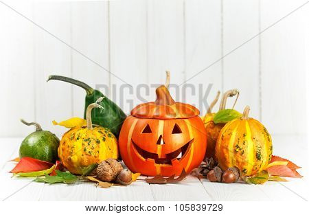 Holiday Halloween autumn decoration with jack-o-lantern pumpkins and yellow leaves. Illustration
