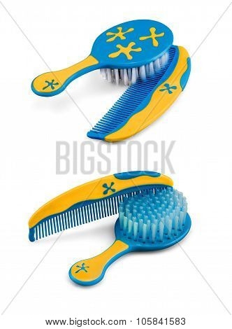 Two Baby And Kid Hairbrush And Comb Isolated On White
