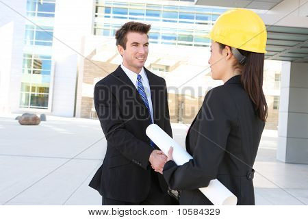 Business Man And Construction Woman