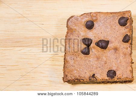 Homemade brownies sliced and  topping on  wooden background