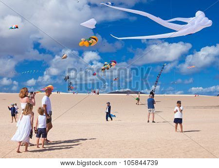 Fuerteventura, Spain - November 09: Viewers Watch From The Ground As Multicolored Kites Fill The Sky