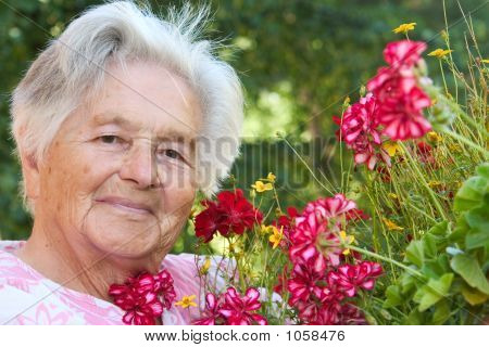 Senior Woman And Flowers