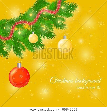Christmas and New Year background with pine tree twigs, glossy balls and trumpery.