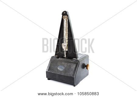 the old metronome isolated on white background