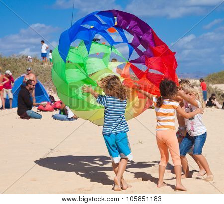 Fuerteventura, Spain - November 10: Kids Trying To Catch One Of The Spinner Kites At 25Th Internatio