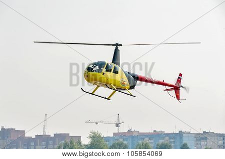 Pilot of Robinson R44 Raven over city