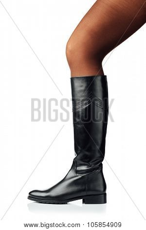 woman leg wearing black leather high boot, isolated on white