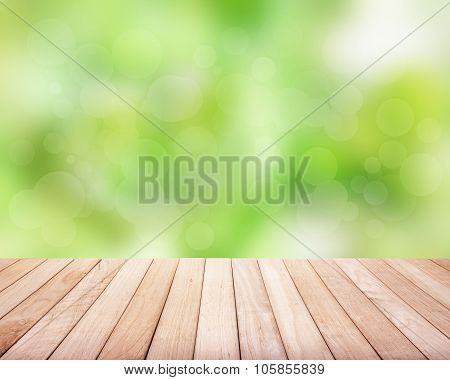 Wooden platform with green plants.