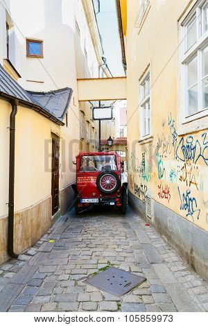 Sightseeing Bus On Narrow Street In Bratislava