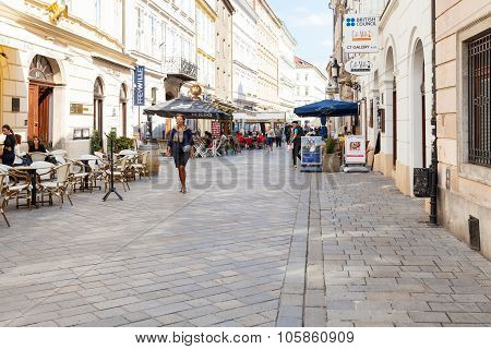 People Walk On Venturska Street In Bratislava