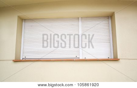 Window On The House Completely Covered With White Horizontal Blinds