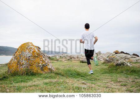 Man Running In The Coast