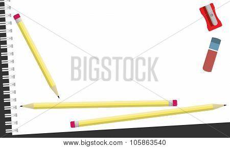Sketchbook, pencils, eraser and sharpener on the dark background