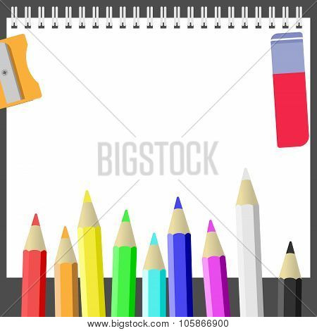 Sketchbook, colored pencils and sharpener on the dark background