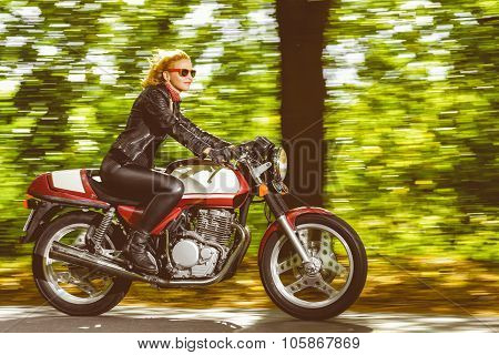 Active girl riding on the motorbike, slow motion, having fun in bikers tour, vintage style photo, ha