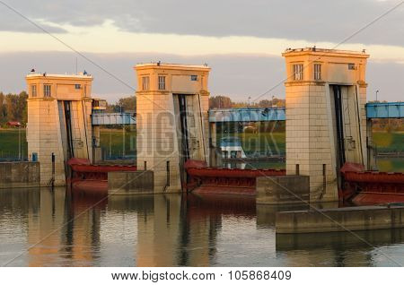 Hydroelectric power plant on the Tisza river at sunset in Tiszalok, Hungary