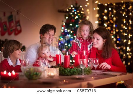 Family Enjoying Christmas Dinner At Home