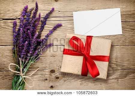 Flowers Of Salvia And Gift Box With Visiting Card On Wooden Background