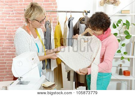 two dressmaker looks at a nice sweater
