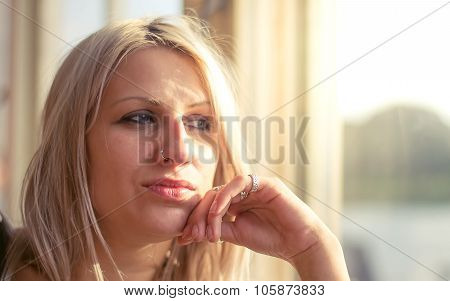 Daydreaming blonde woman