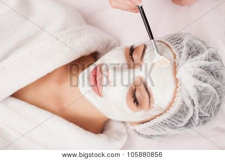 Attractive healthy girl is visiting expert beautician