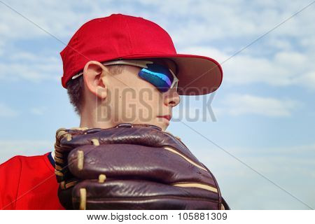 Closeup of a boy pitcher, focus on side of boys face.