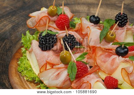 Galia Melon, Melon With Ham, Raspberries, Blueberries, Blackberries And Olives