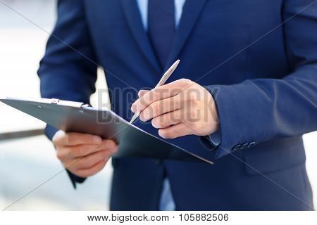 Clipboard and writing pen in usage.
