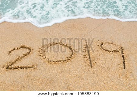 2019 Inscription Written On Sandy Beach With Wave Approaching