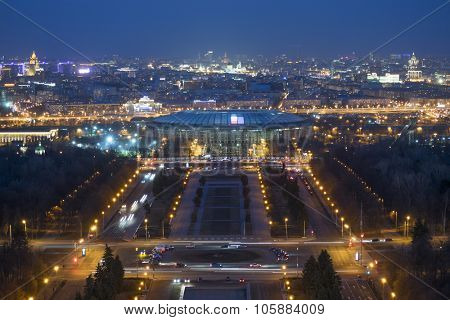 Luzhniki sport complex and park with illumination at night in Moscow