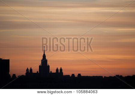Silhouette of main building of Lomonosov Moscow State University during sunrise