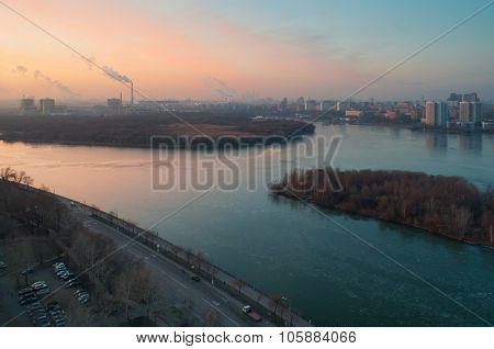 Nagatinskaya quay, sunrise and Moskva river with floating ice in Moscow